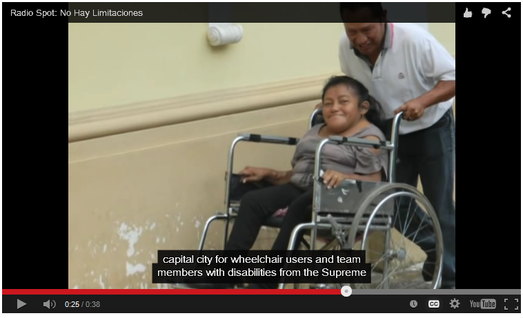 In the background is a photo of a woman using a wheelchair to move up a ramp. Captions are shown below.